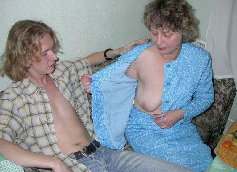 Mature woman and young guy having fun 5